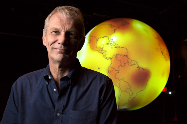 Goddard Space Center-May 13: Portrait of NASA Astronaut Piers Sellers, who has stage 4 pancreatic cancer, plans to continue his work researching the effects and causes of climate change. Here he stands in front of a globe that show the increase in temperatures on earth in 2015.